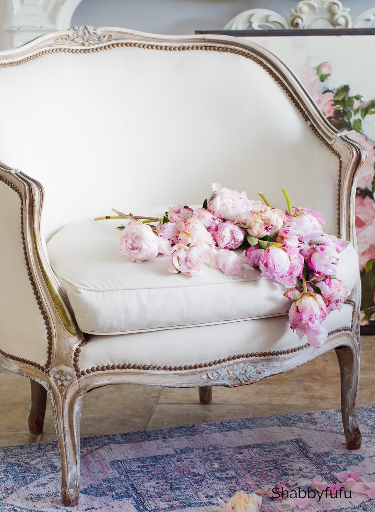 french bergere chair with peonies