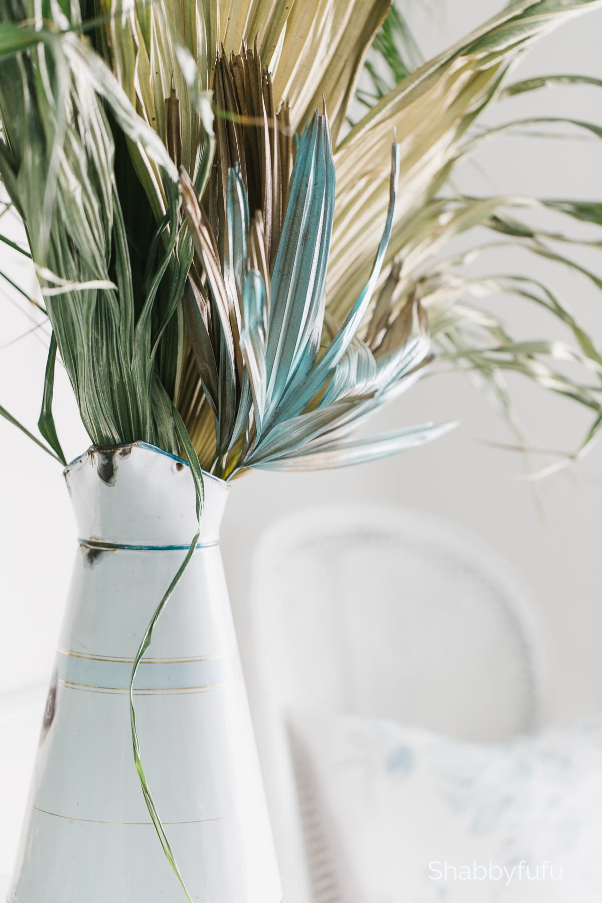 dried palm fronds in a table setting
