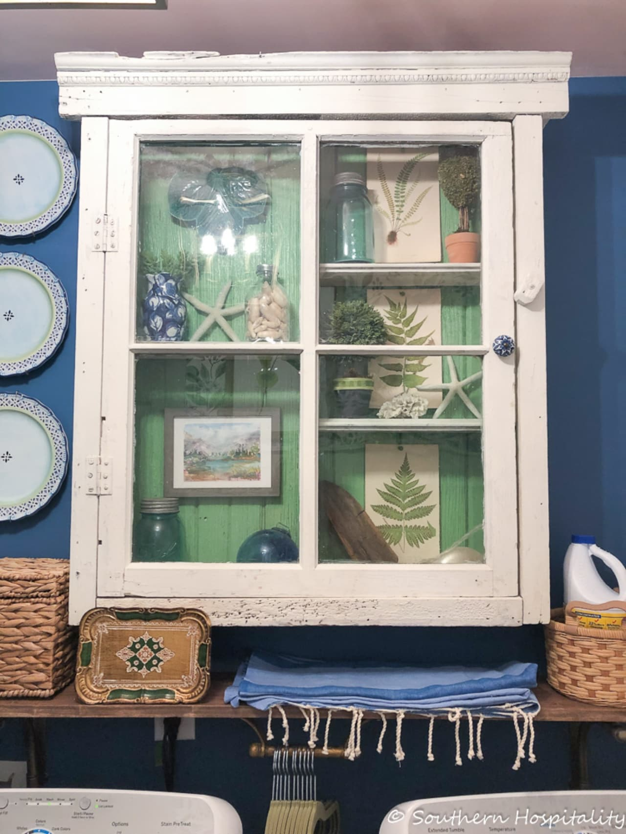 vintage wall cabinet with glass doors