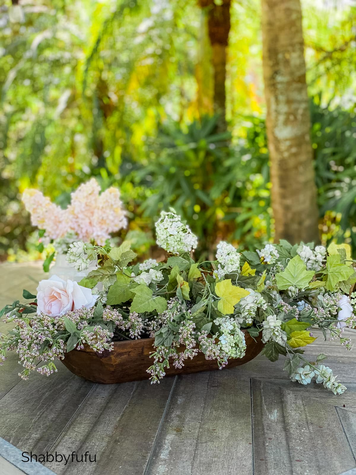 dough bowl with a variety of flowers in an arrangement