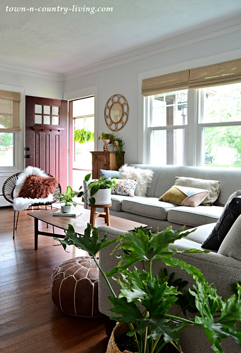 mid century style living room with wood floors and white furniture