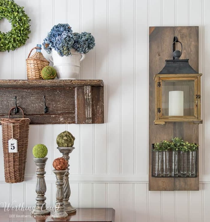 lantern and vintage shelf hanging on a white wall with other farmhouse accessories