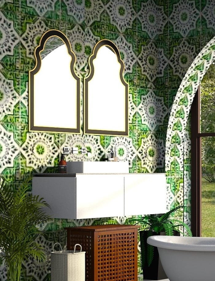 wall mounted sink with green and white bold patterned wall paper and two Moroccan shaped mirrors