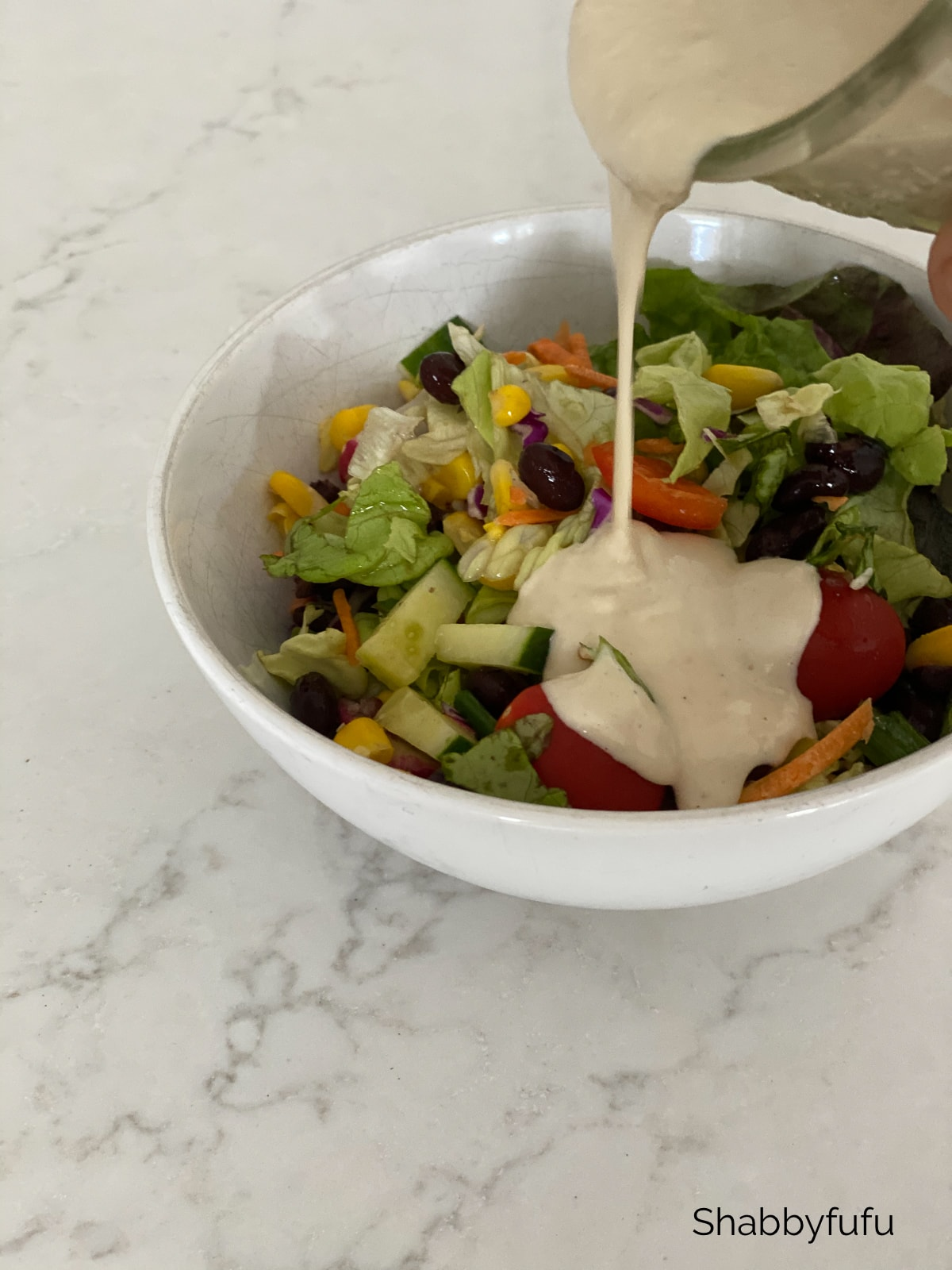 I try to eat a salad as big as my head every day! Home made vegan dressing