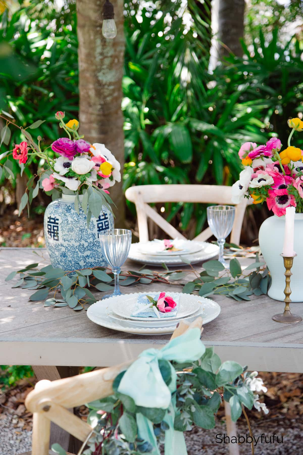 Miami garden outdoor table setting under the palm trees