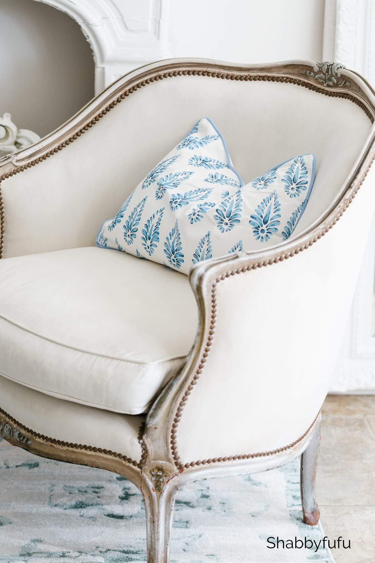 French chair with blue and white pillow