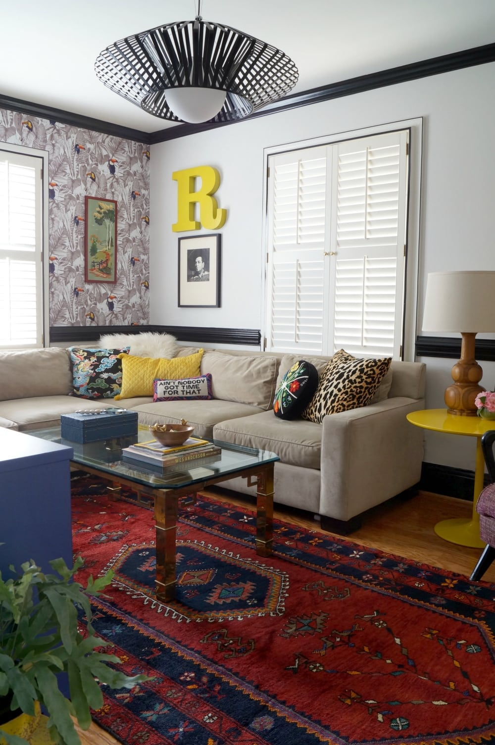 Eclectic-colorful-collection-mid-century-furiture-living-room-colorful-removable-wallpaper-toucan-mixing-pattern-persian-rug