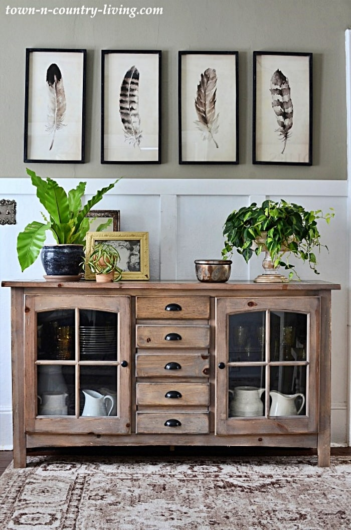 grouping of wall art above a console table