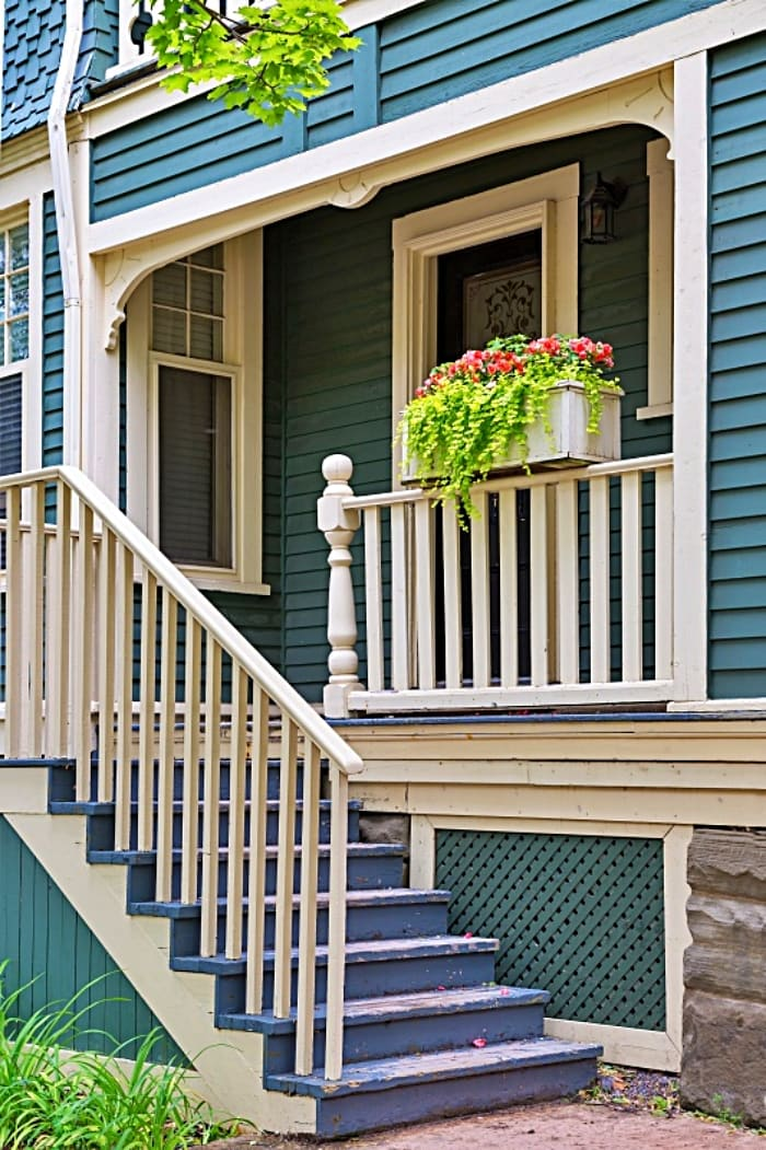 front porch on a house with blue siding and white trim
