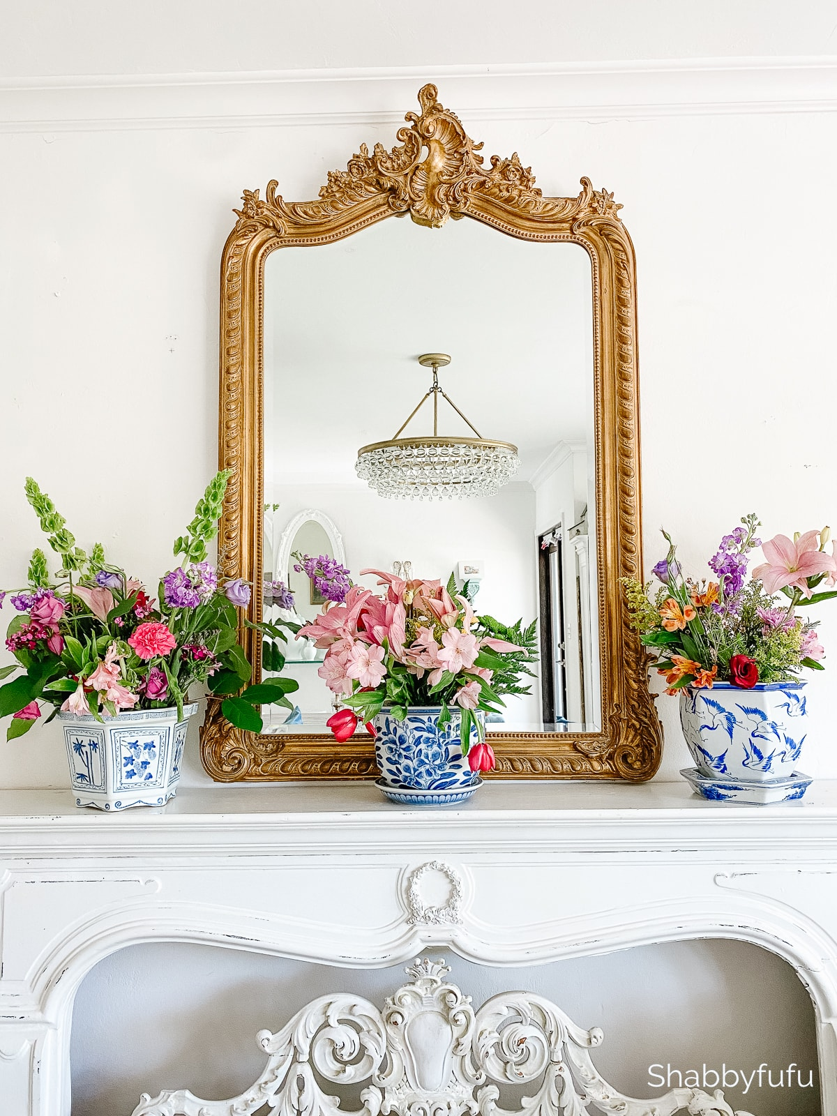 french mantel with floral arrangements