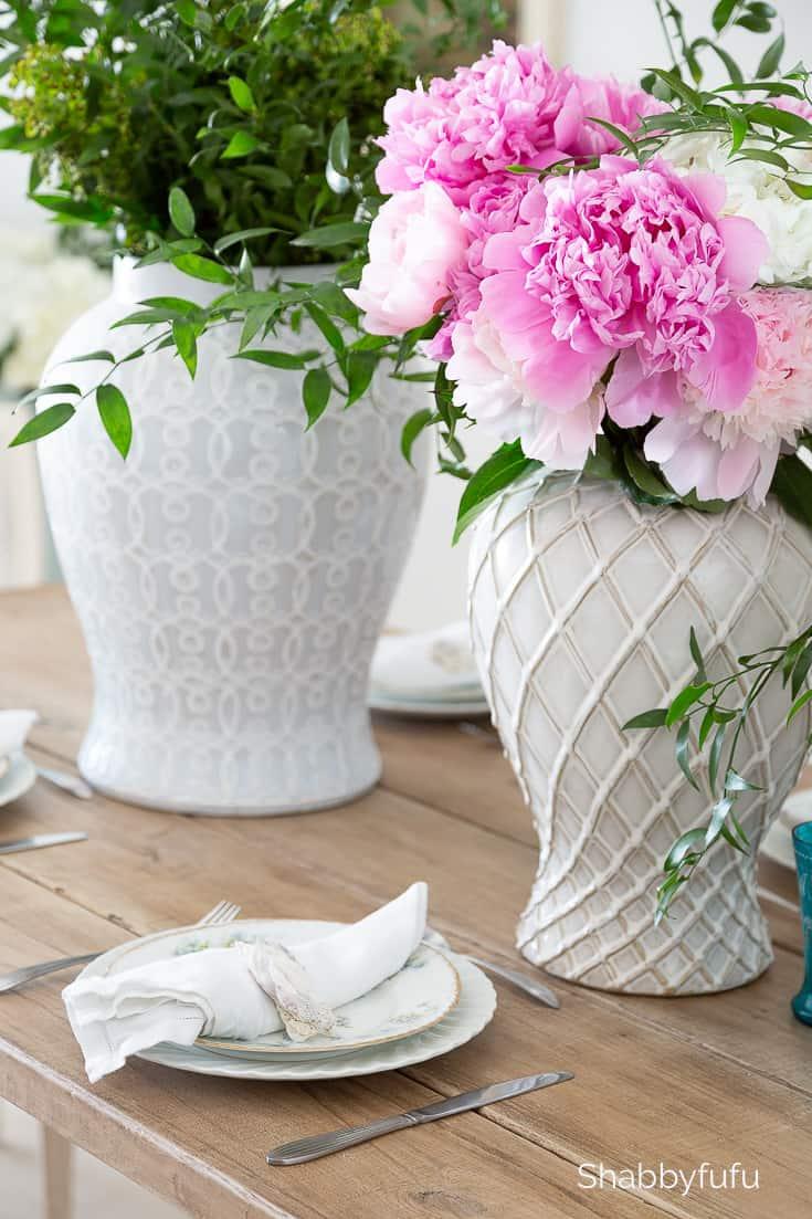 pink peonies in a white vase