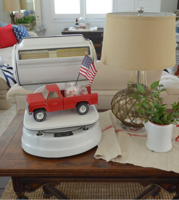 patriotic vignette with a red truck