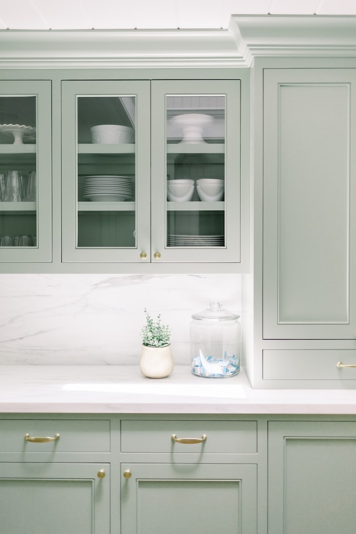 gray cabinets and white counter in a kitchen