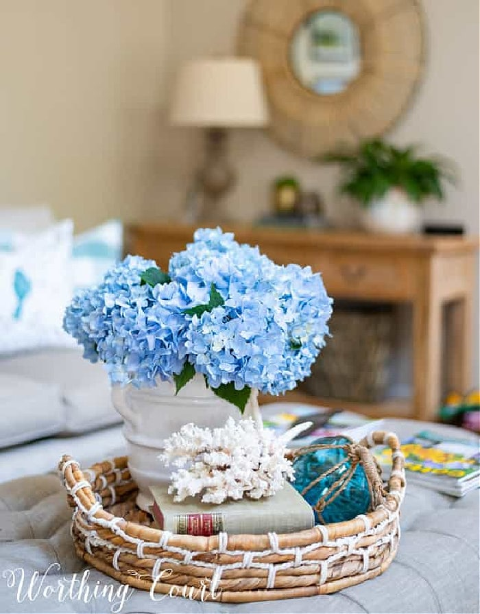 coffee table vignette with blue hydrangeas