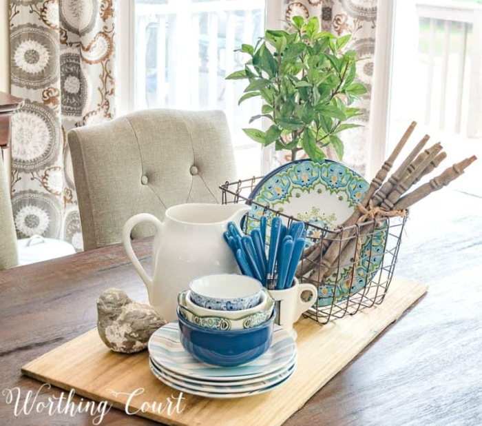 centerpiece with blue and white dishes on a breadboard