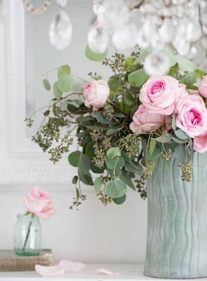 pale blue vase with pink roses
