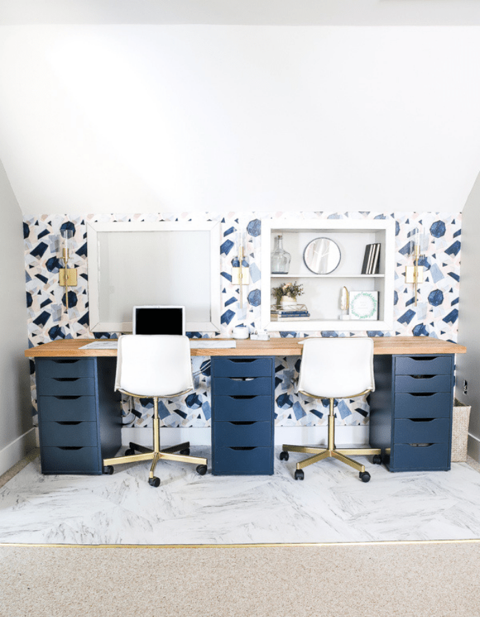 after modern feminine home office DIY makeover with blue and pink wallpaper and large dual desk