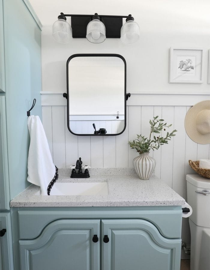 after picture of remolded bathroom with oak wood furniture inhome tour of avid crafter