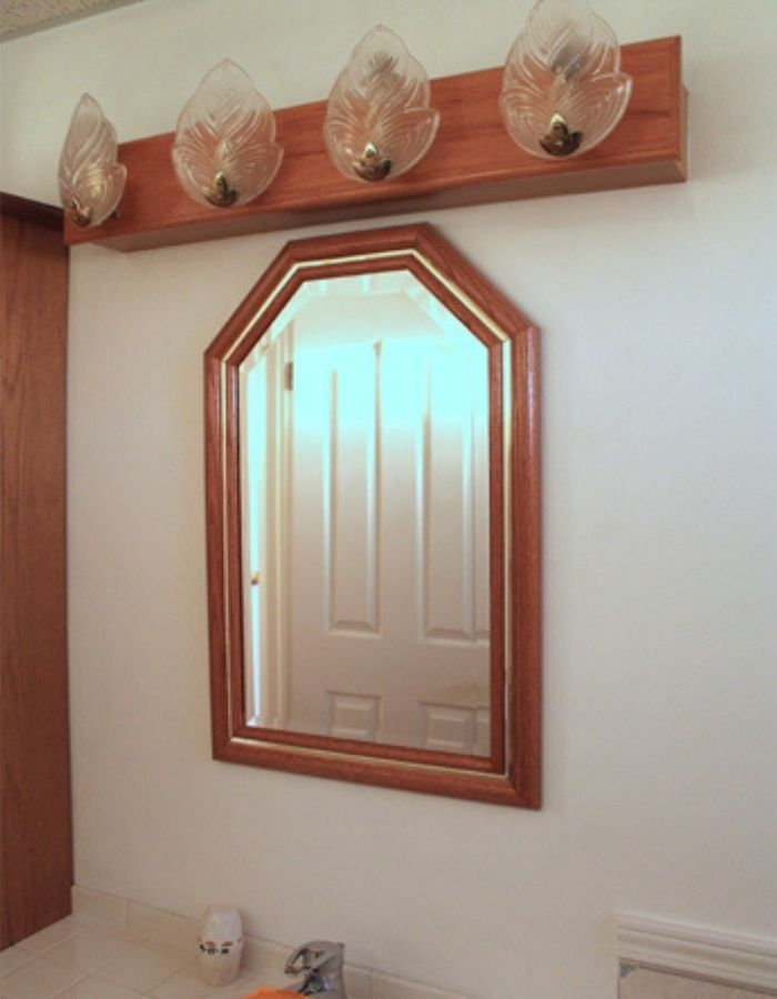 mirror before picture of dated bathroom with oak wood furniture inhome tour of avid crafter