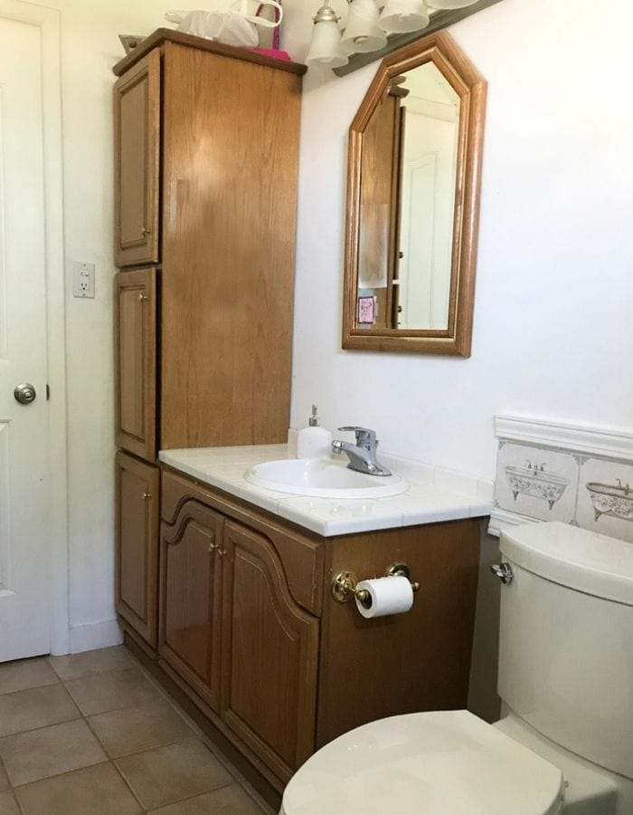before picture of dated bathroom with oak wood furniture inhome tour of avid crafter