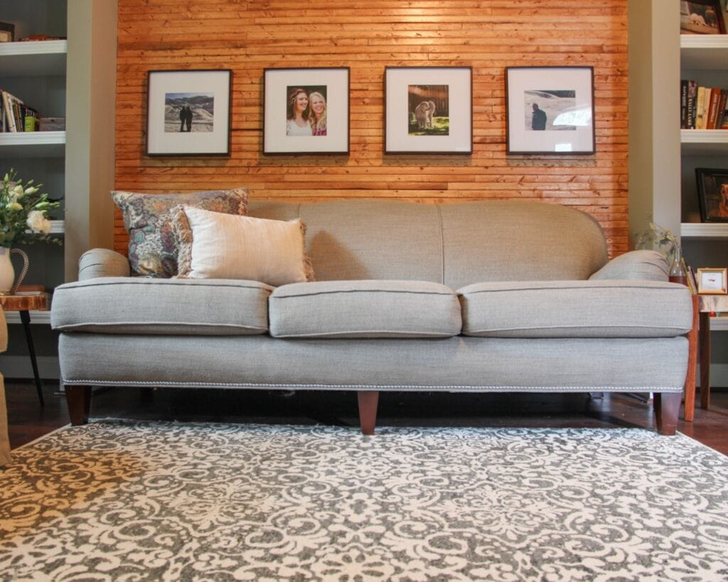 living room of DIY slat wood wall after picture with warm wood