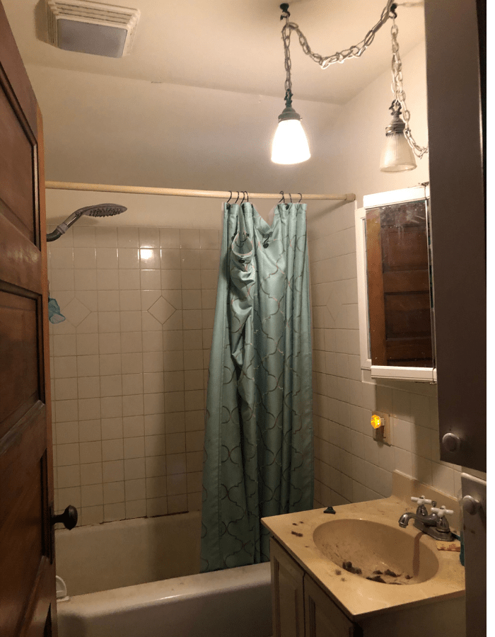 old bathroom before makeover, blue shower curtains, sink