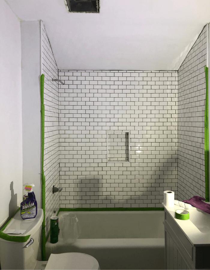 bathroom during renovations, Subway tiles wall