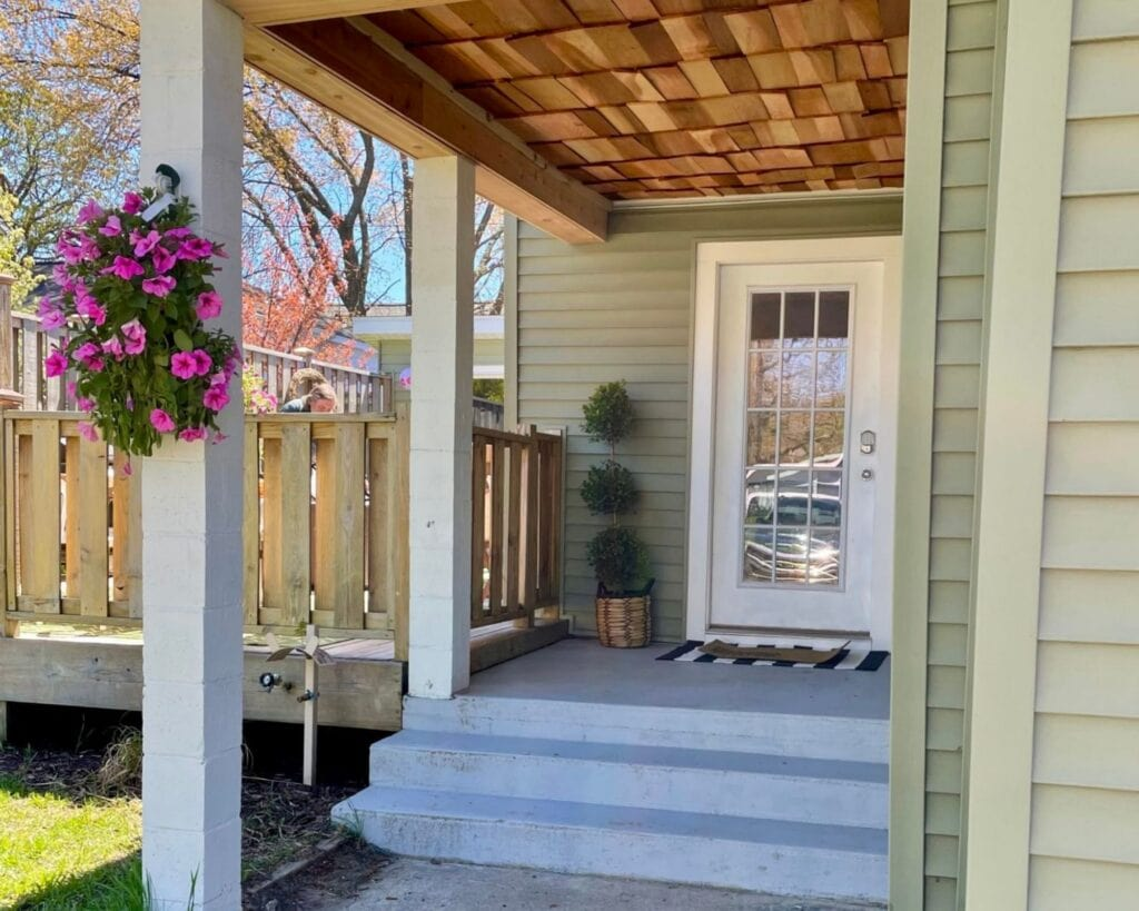 Entryway of a home, white door, stars, deck