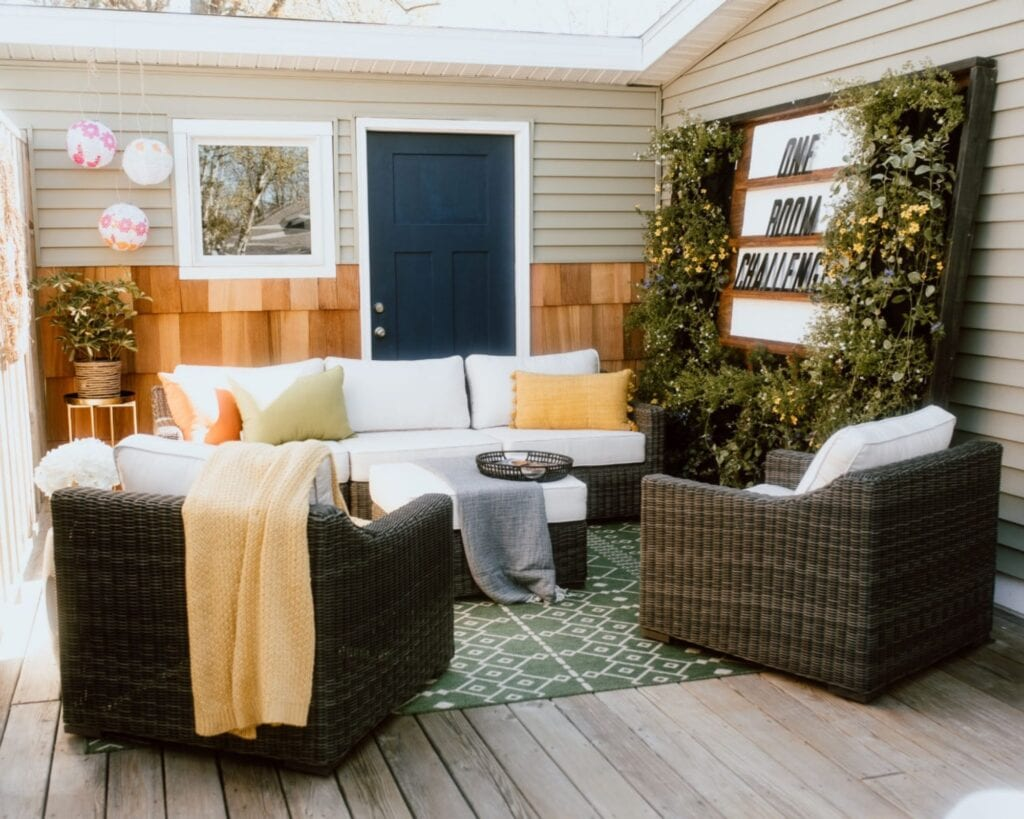 Features outdoor deck with living plant wall and board with text