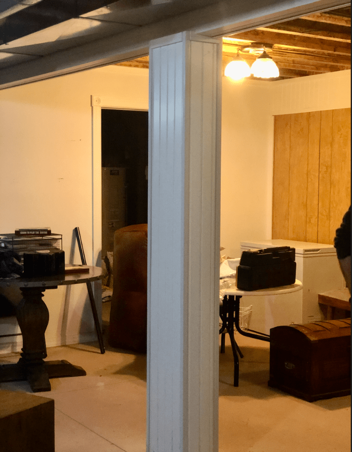 before picture of dated room basement