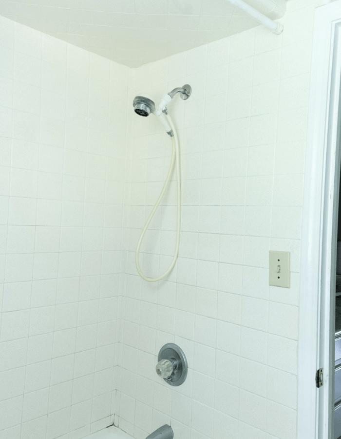dated shower corner in bathroom before renovations