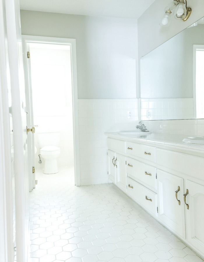 all white bathroom before makeover renovations