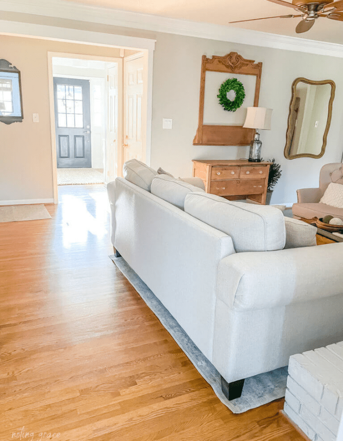 living room in farmhouse style home after removing inner wall during makeover