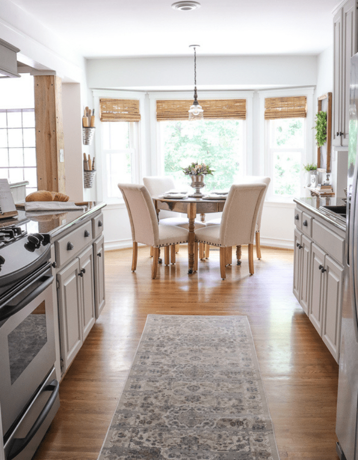 makeover farmhouse styled renovation small kitchen dining area with round table and chairs