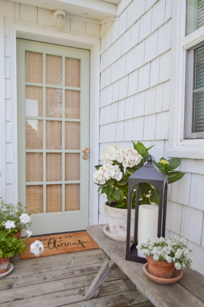 gray french door on a house with gray shingle siding