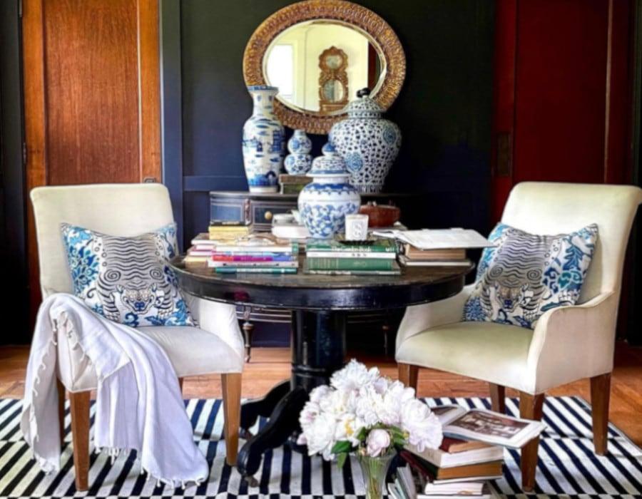elegant dining room with a dark color scheme after decor makeover