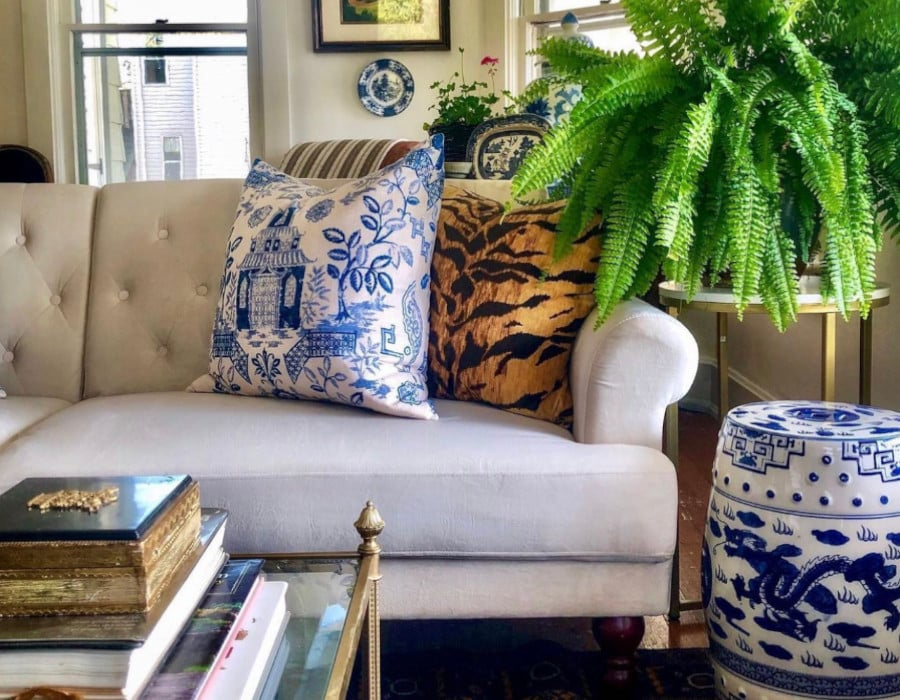 stylish grandmilenial farmhouse living room with greenery and blue accents
