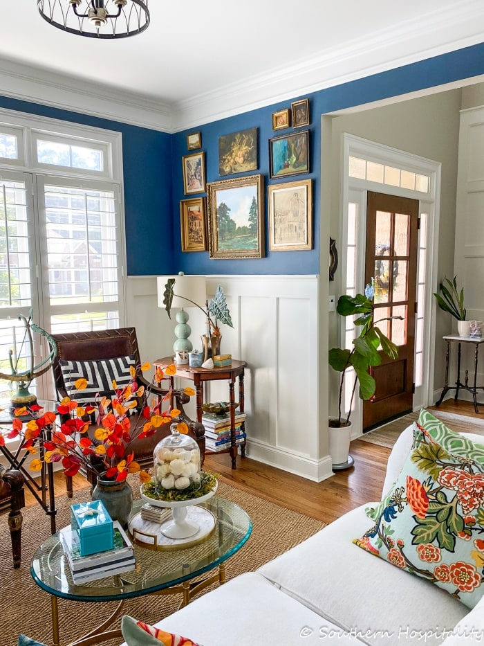 living room with white and blue walls and transitional decor