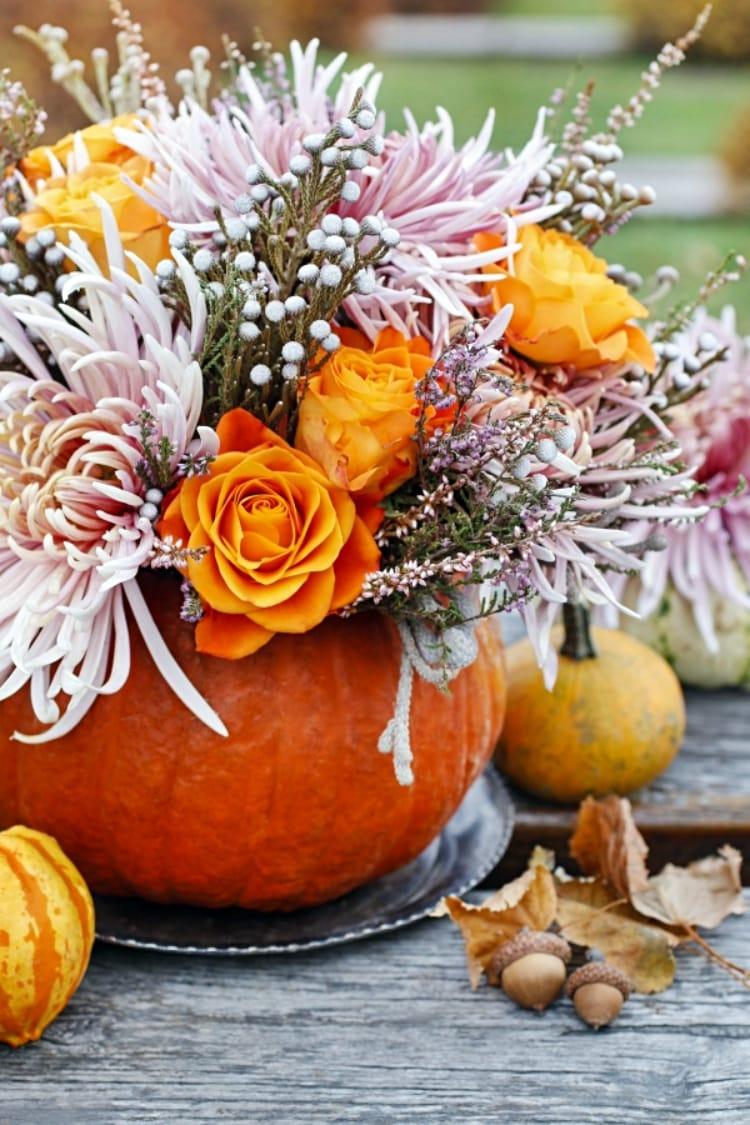 multi colored flower arrangement in a pumpkin