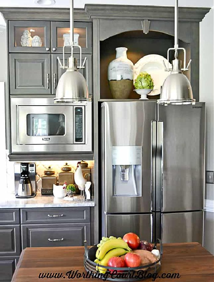 gray kitchen cabinets with stainless steel appliances