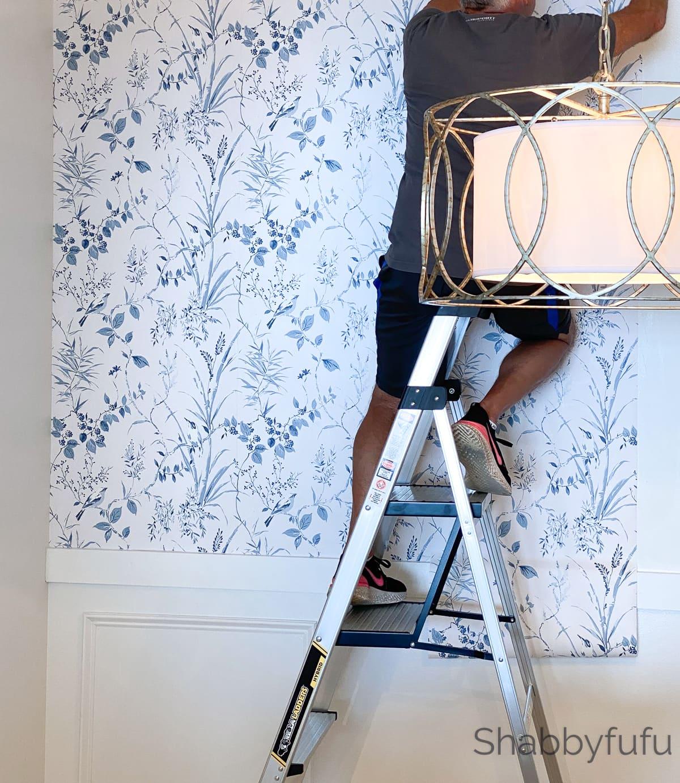 installing wallpaper in the breakfast room banquette